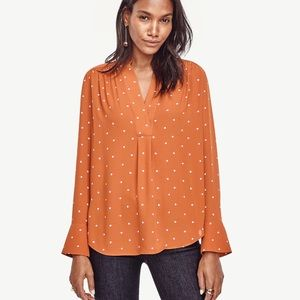 Ann Taylor Dotted V Neck blouse in orange, Small